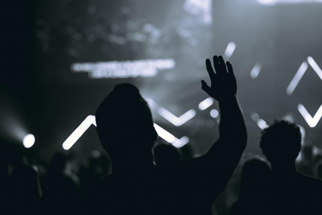 concert hands raised win worship